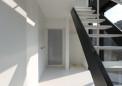 06_階段下に洗濯機置場・家事室を兼ねる